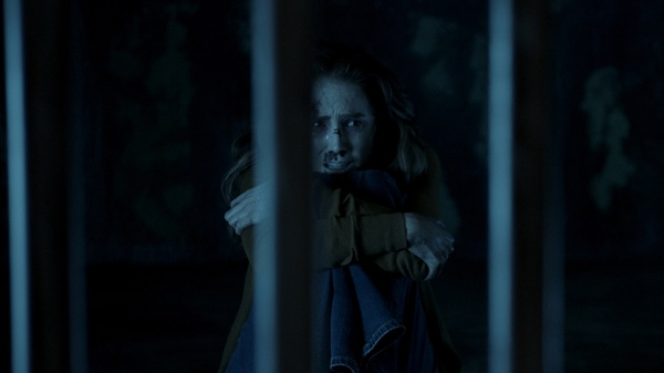 Melissa (Spencer Locke) could reeaaally use that key right about now, in Insidious: The Last Key.