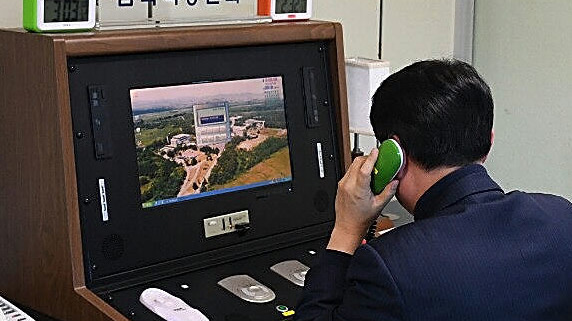 A South Korean government official checks the hotline to talk with the North Korean side at the border village of Panmunjom on January 3. South Korea says North Korea has agreed to meet at the village next week.