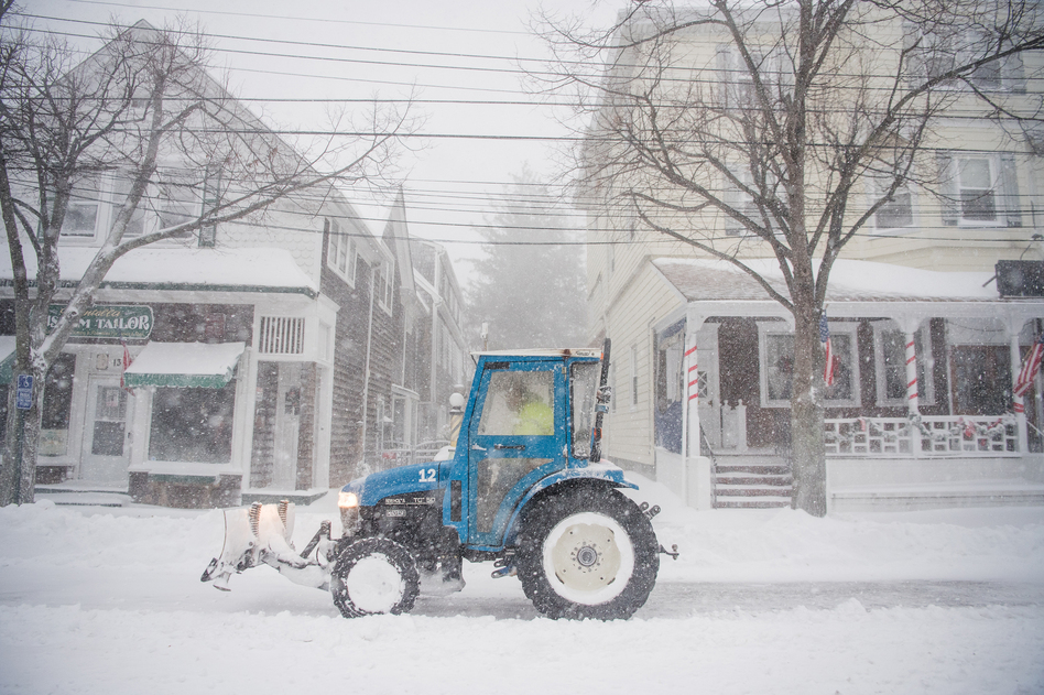A plow clears snow in Bellport, N.Y., as a winter storm hits the Northeast on Thursday. (Andrew Theodorakis/Getty Images)