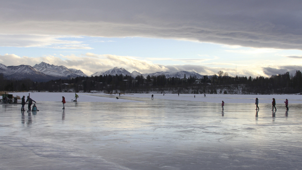 Ice skaters in Anchorage, AK take advantage of warmer than average temperatures at Westchester Lagoon.