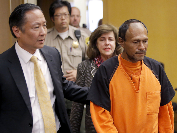 Jose Ines Garcia Zarate is led into the courtroom by San Francisco Public Defender Jeff Adachi in July 2015.