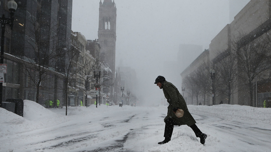 A man walks through the streets of Boston on Thursday as snow falls from a massive winter storm. Schools and businesses throughout the Boston area were closed during the storm. (Spencer Platt/Getty Images)