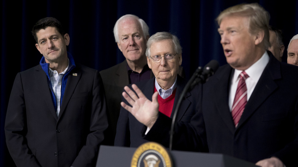 President Trump, with House Speaker Paul Ryan of Wisconsin, Senate Majority Whip John Cornyn, R-Texas., and Senate Majority Leader Mitch McConnell of Kentucky, speaks to reporters after a retreat where GOP leaders made plans for 2018. (Andrew Harnik/AP)
