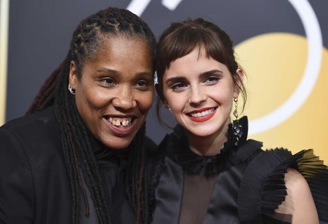 Marai Larasi, left, and Emma Watson arrive at the 75th annual Golden Globe Awards.
