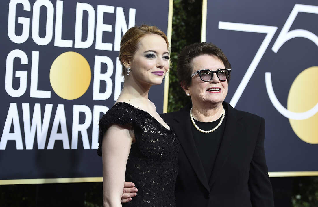 Emma Stone, left, and Billie Jean KIng arrive at the 75th annual Golden Globe Awards .