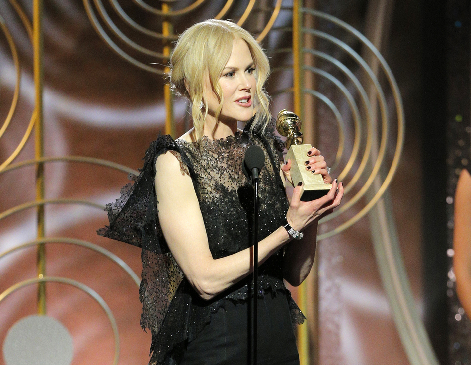 """Nicole Kidman accepts the award for best performance by an actress in a limited series or motion picture made for TV for her role in """"Big Little Lies."""" (Paul Drinkwater/AP)"""