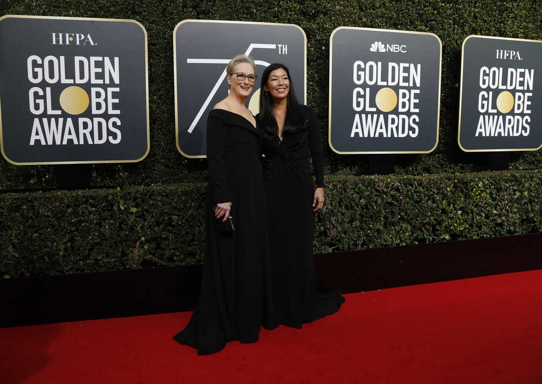 Actress Meryl Streep, left, and the director of the National Domestic Workers Alliance, Ai-jen Poo qrrive at 5th Golden Globe Awards
