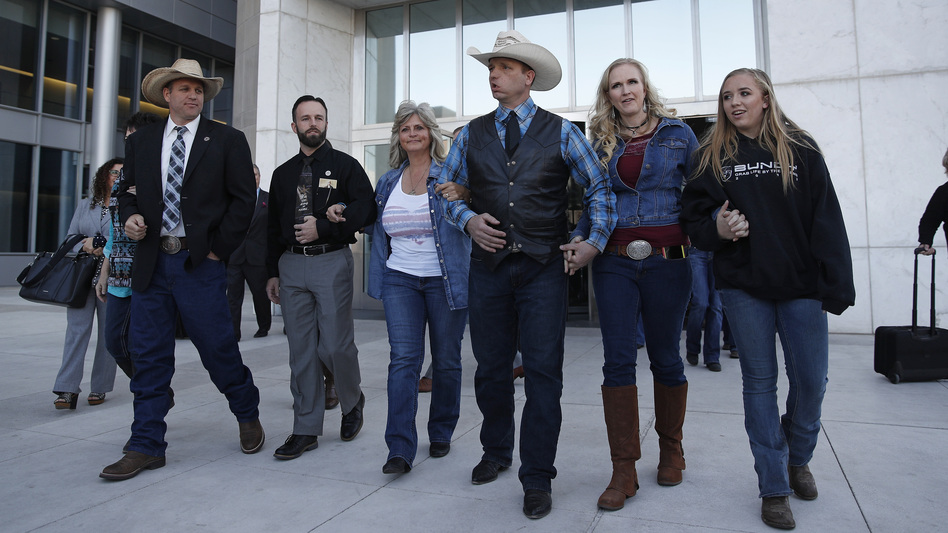 "Ammon Bundy (from left), Ryan Payne and Ryan Bundy on the day a mistrial was declared last month. They were joined by Jeanette Finicum, widow of Robert ""LaVoy"" Finicum, and Ryan's wife and daughter. (John Locher/AP)"