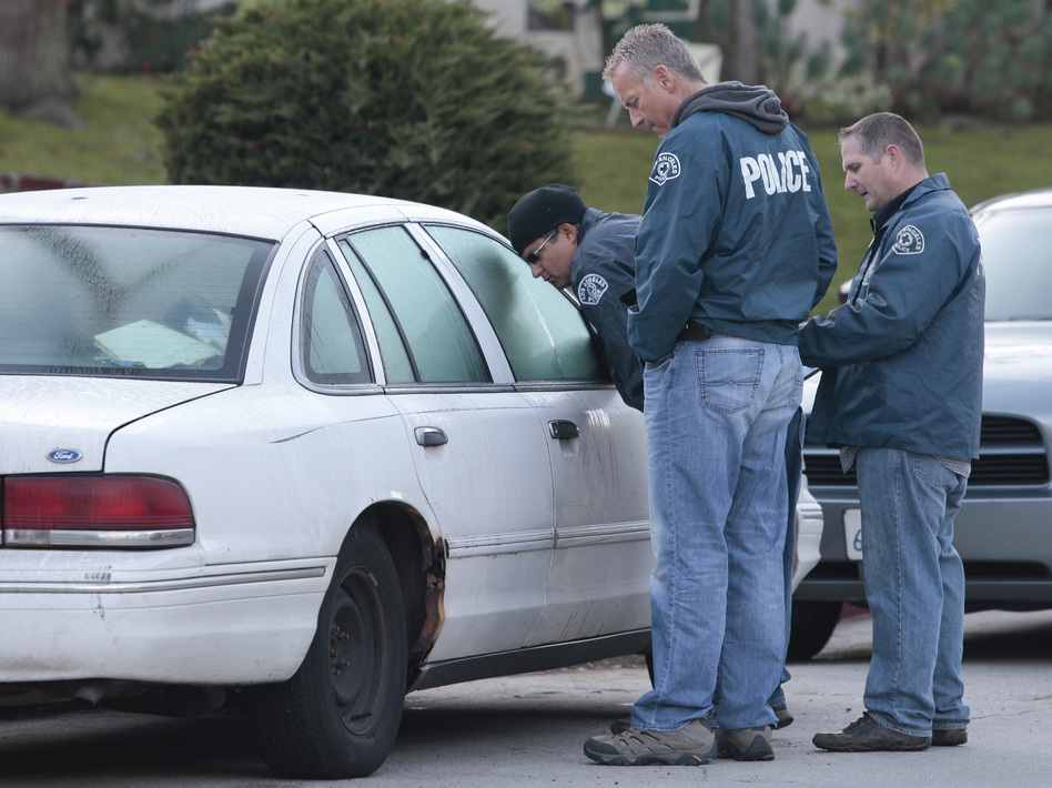 Los Angeles Police inspect a vehicle parked in the same neighborhood as a crime scene in 2012. The Supreme Court heard arguments on Tuesday regarding when police can search a vehicle without a warrant. (Jason Redmond/AP)