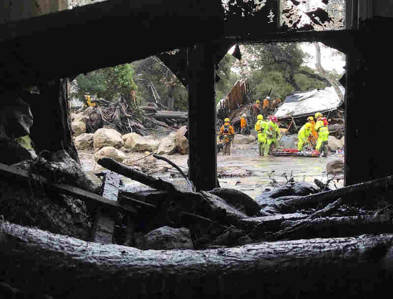Santa Barbara County Fire Department firefighters respond to mud and debris flow caused by heavy rains in Montecito.