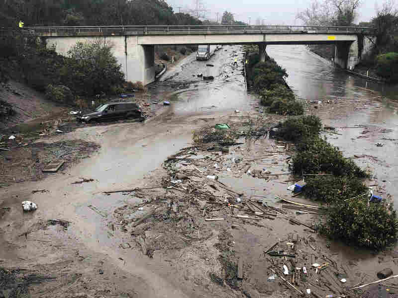 U.S. Highway 101 at the Olive Mill Road overpass is flooded with runoff water from Montecito Creek in Montecito