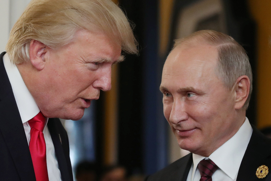 President Trump chats with Russian President Vladimir Putin as they attend a meeting at the Asia-Pacific Economic Cooperation summit in Vietnam in November. (Mikhail Klimentyev/AFP/Getty Images)