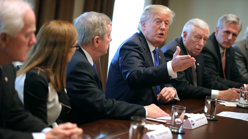 President Trump presides over a meeting about immigration with Republican and Democratic members of Congress at the White House on Tuesday. Congress and the White House are trying to work out an immigration deal prior to Jan. 19. (Chip Somodevilla/Getty Images)