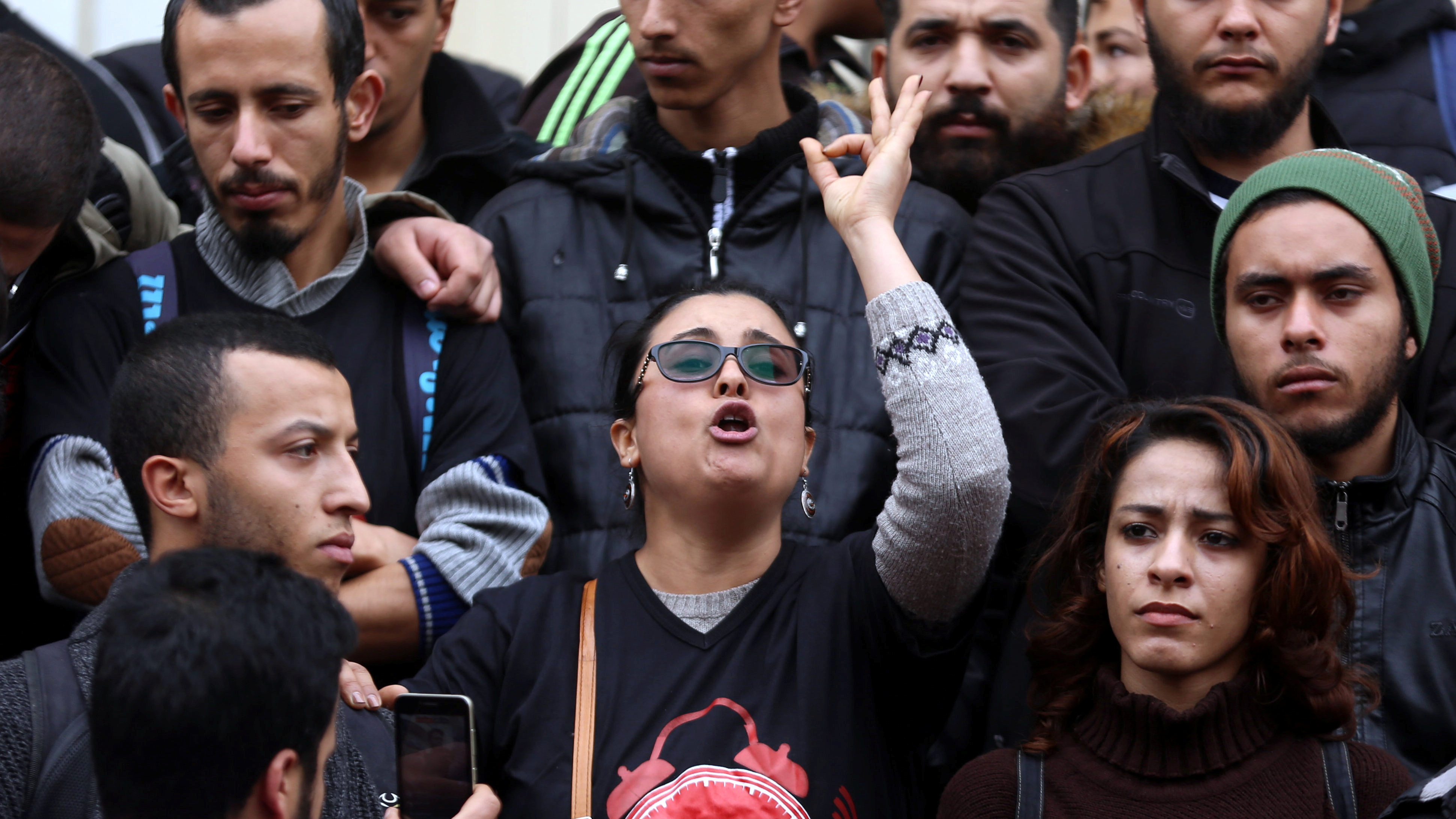 A demonstrating graduate shouts slogans during protests against rising prices and tax increases in Tunis on Tuesday