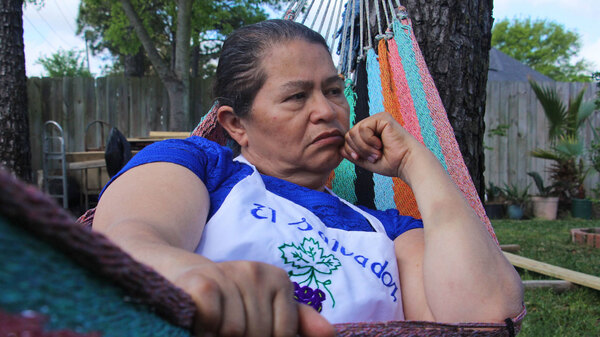 This portrait of a woman from El Salvador reflects the wariness and uncertainty discussed in Alt.Latino this week.