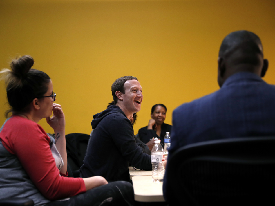 Facebook CEO Mark Zuckerberg laughs as he meets with a group of entrepreneurs and innovators during a roundtable discussion at Cortex Innovation Community technology hub, in November, in St. Louis. (Jeff Roberson/AP)