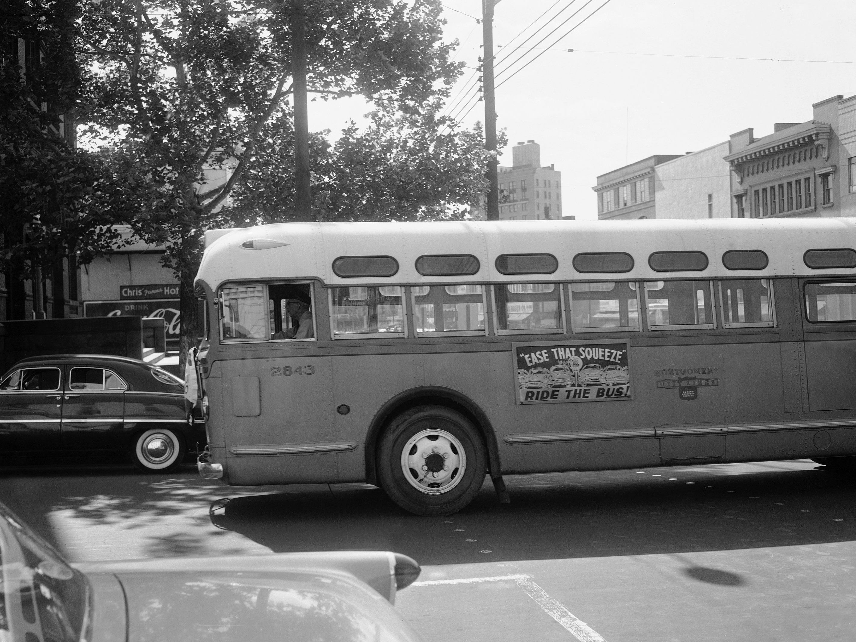 A bus driver is all alone as his empty bus moves through downtown Montgomery, Ala., in April 1956 during the boycott. Georgia Gilmore's cooking helped fund an alternative system of transportation that arose for the city's African-Americans during the boycott. (Horace Cort/AP)