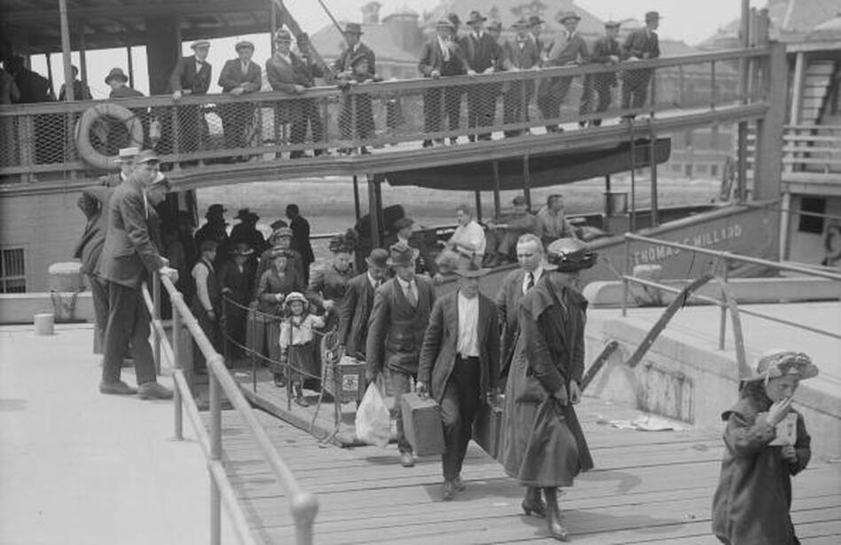 Immigrants arrive at Ellis Island in Upper New York Bay around 1900. In 1924, the U.S. would restrict immigration based on national origin. Forty years after that, it eliminated those restrictions. (Buyenlarge/Getty Images)
