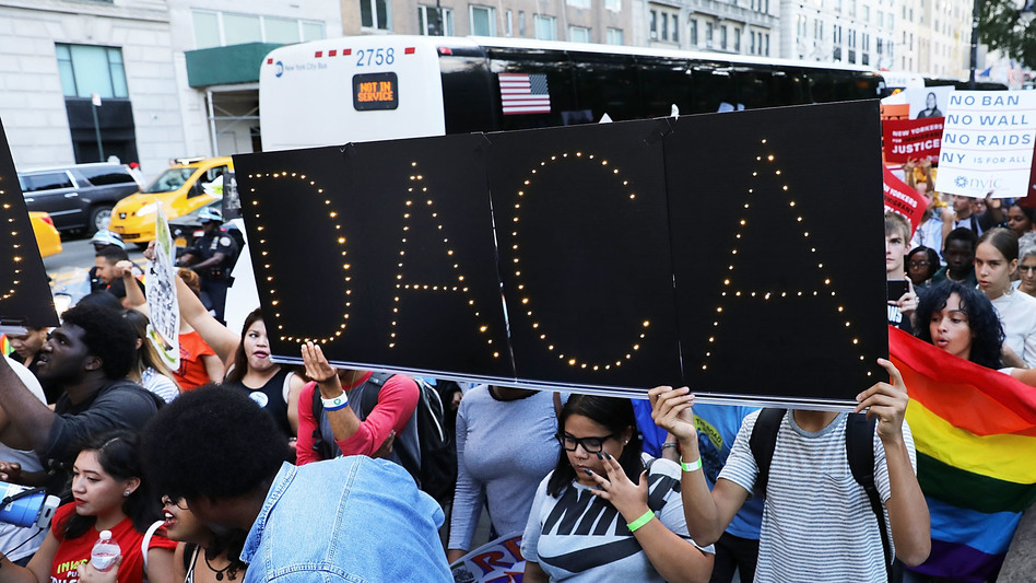 DACA advocates march near Trump Tower in August in New York City. The government says it will resume DACA renewals. (Spencer Platt/Getty Images)