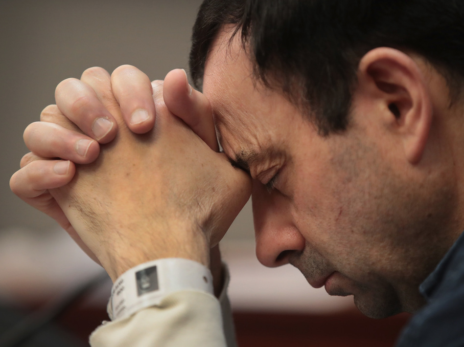 Larry Nassar listens to victim impact statements prior to being sentenced after being accused of molesting more than 140 women and girls while he was a physician for Team USA and Michigan State University. Nassar has pleaded guilty in Ingham County, Mich., to sexually assaulting seven girls, but the judge is allowing all of his accusers to speak. (Scott Olson/Getty Images)