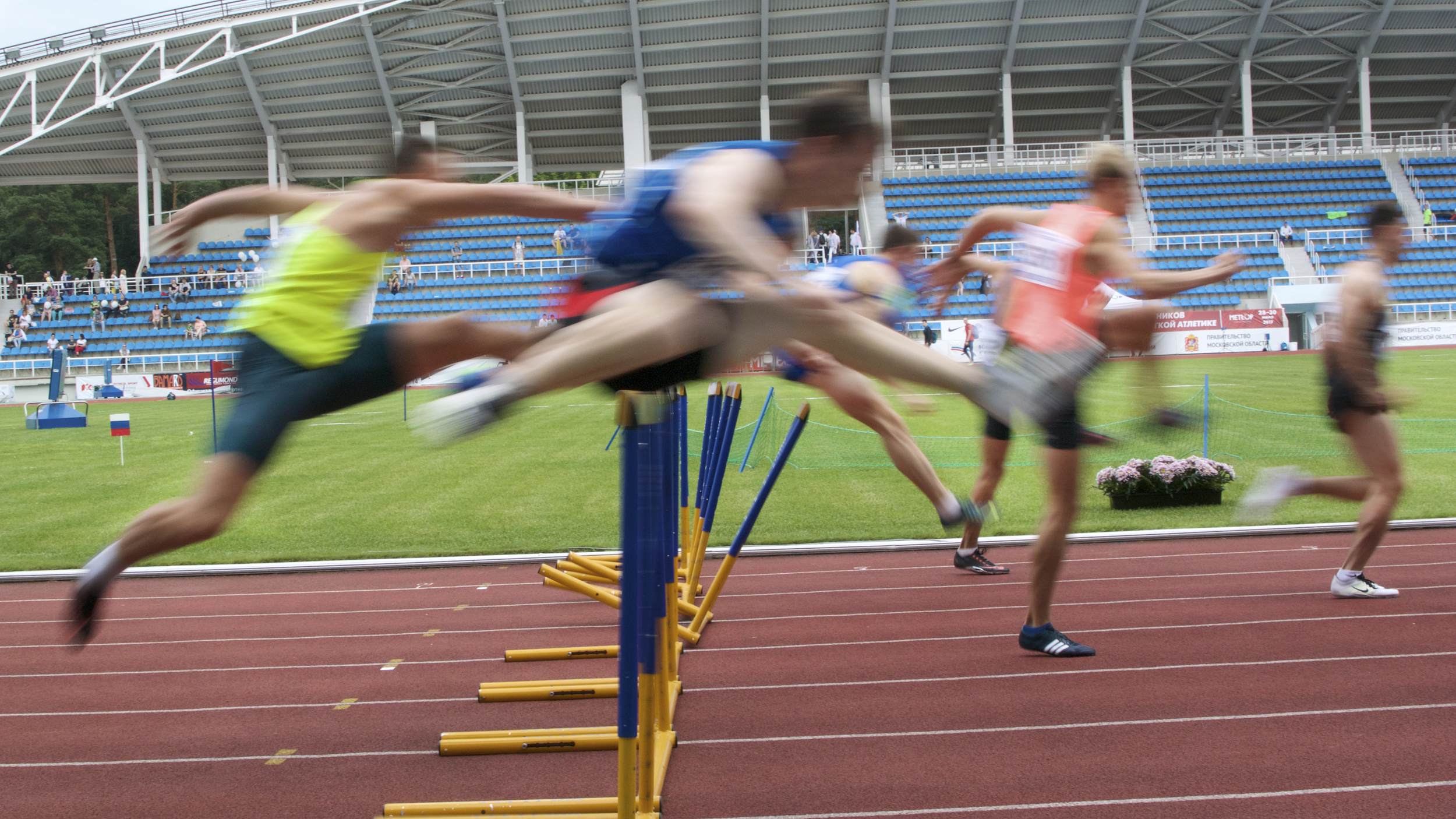 Athletes compete in the 110-meter hurdles semifinal run during the national track and field championship in Moscow in July 2017