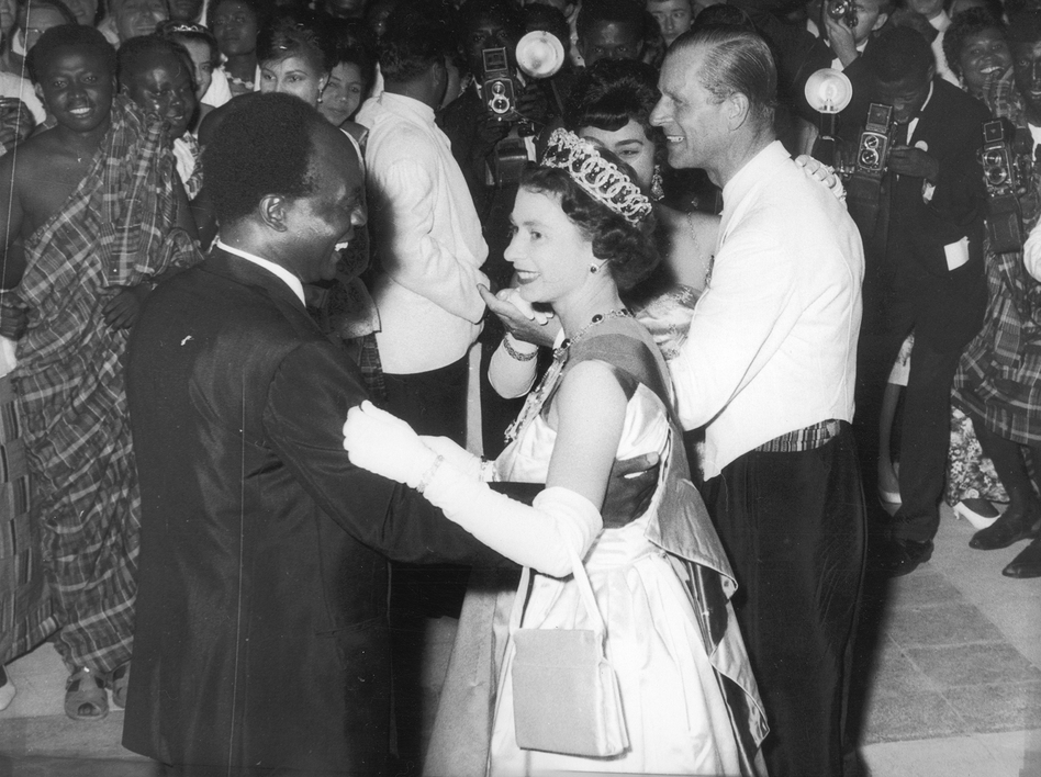 Queen Elizabeth II dances with Ghanaian president Kwame Nkrumah at a ball in Accra, Ghana, in 1961. (Central Press/Getty Images )