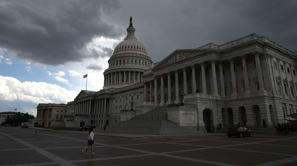 Dark clouds hover over the U.S. Capitol in Washington D.C. last June.