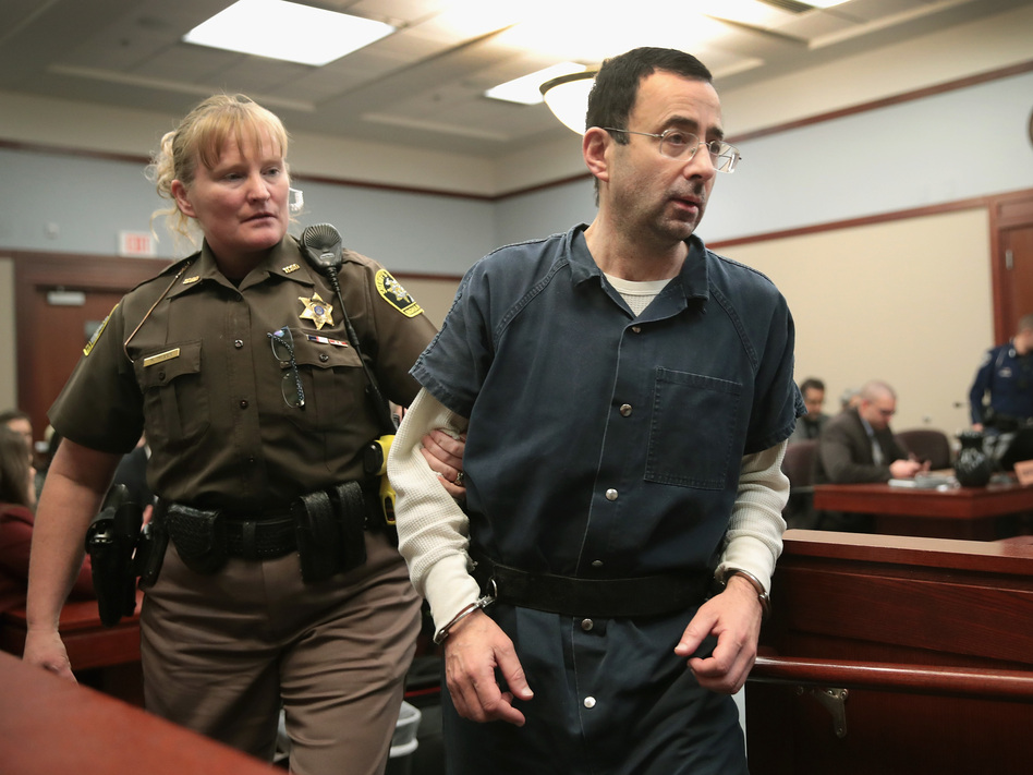 Larry Nassar appears in court last Wednesday in Lansing, Mich., to listen to victim impact statements during his sentencing hearing. He is accused of molesting more than 100 girls while he was a physician for USA Gymnastics and Michigan State University. (Scott Olson/Getty Images)