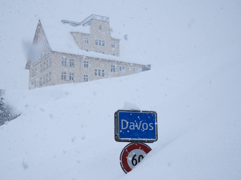 The town sign stands in the snow at the entrance to Davos, Switzerland, host to the 48th annual meeting of the World Economic Forum taking place this week. Donald Trump will be among the attendees. (David Keyton/AP)