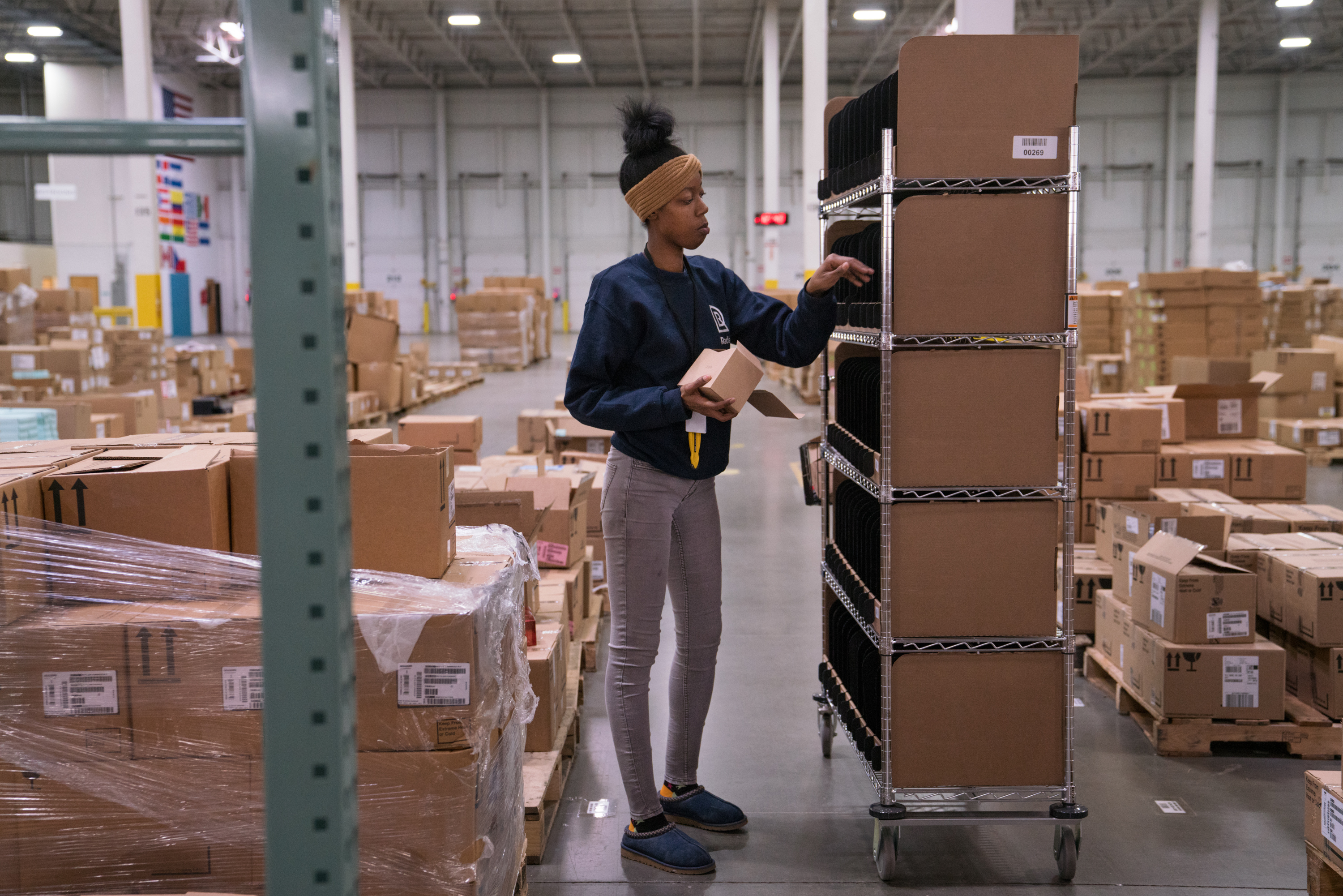 'Don't Think A Robot Could Do This': Warehouse Workers Aren't Worried For Their Jobs