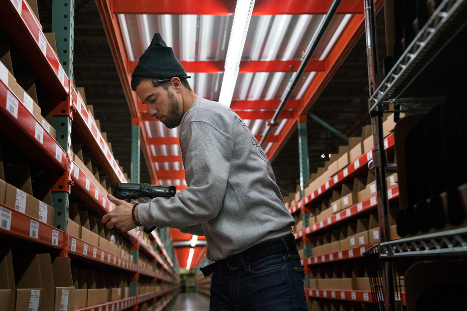 Chris Beatty, 26, works at a Radial warehouse in Burlington, N.J. (Claire Harbage/NPR)