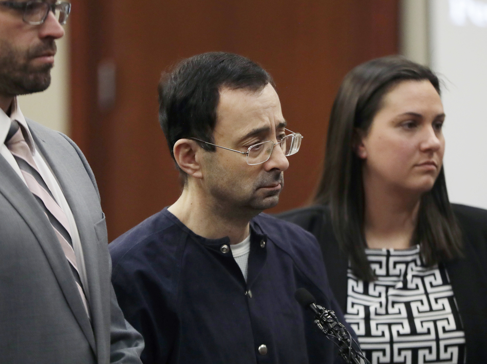 Larry Nassar in court with his attorneys on Wednesday, in Lansing, Mich., where he was sentenced to 40 to 175 years in prison. (Carlos Osorio/AP)