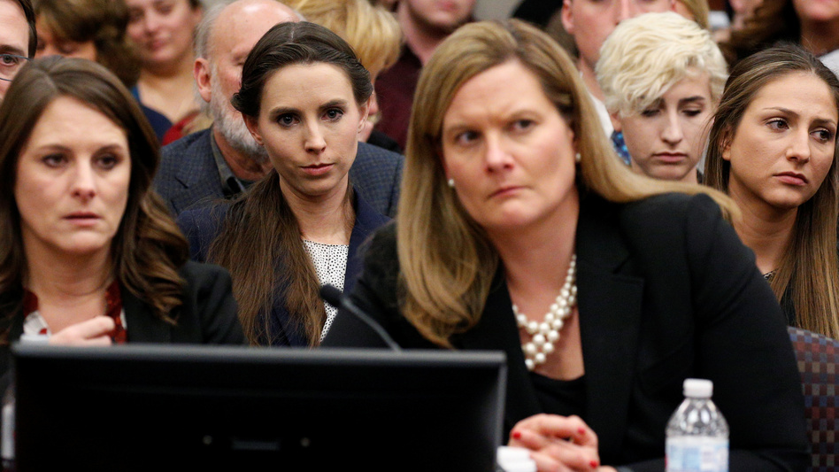 The entire USA Gymnastics board will resign, the group says. Rachael Denhollander (center) listens as Larry Nassar, a former team USA Gymnastics doctor, was sentenced to up to 175 years in prison for sexual abuse over decades of his involvement with the program. (Brendan McDermid/Reuters)