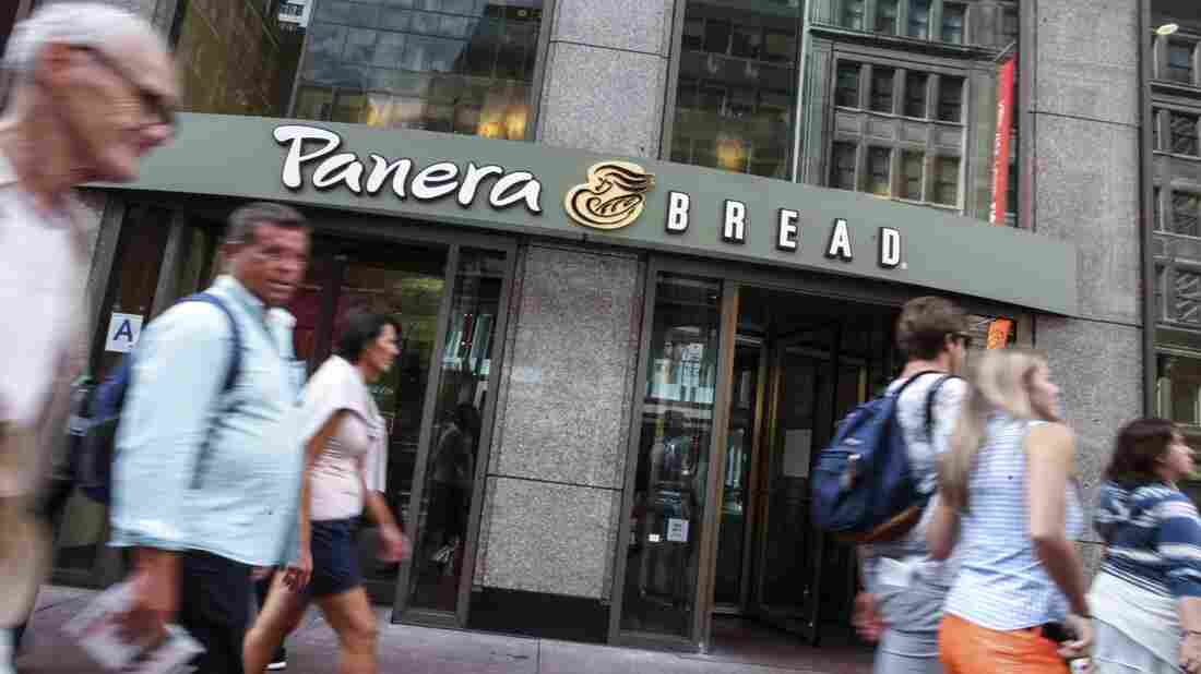 People walk by a Panera Bread in Manhattan in 2015.