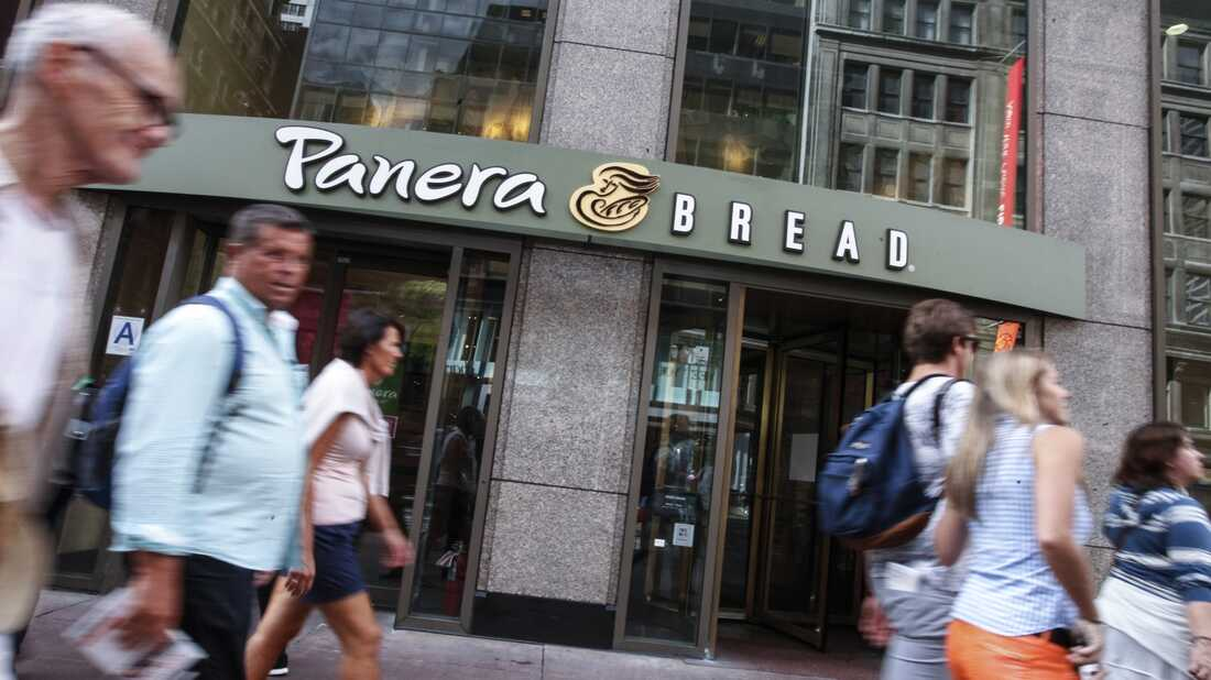 People walk by a Panera Bread in Manhattan in 2015.