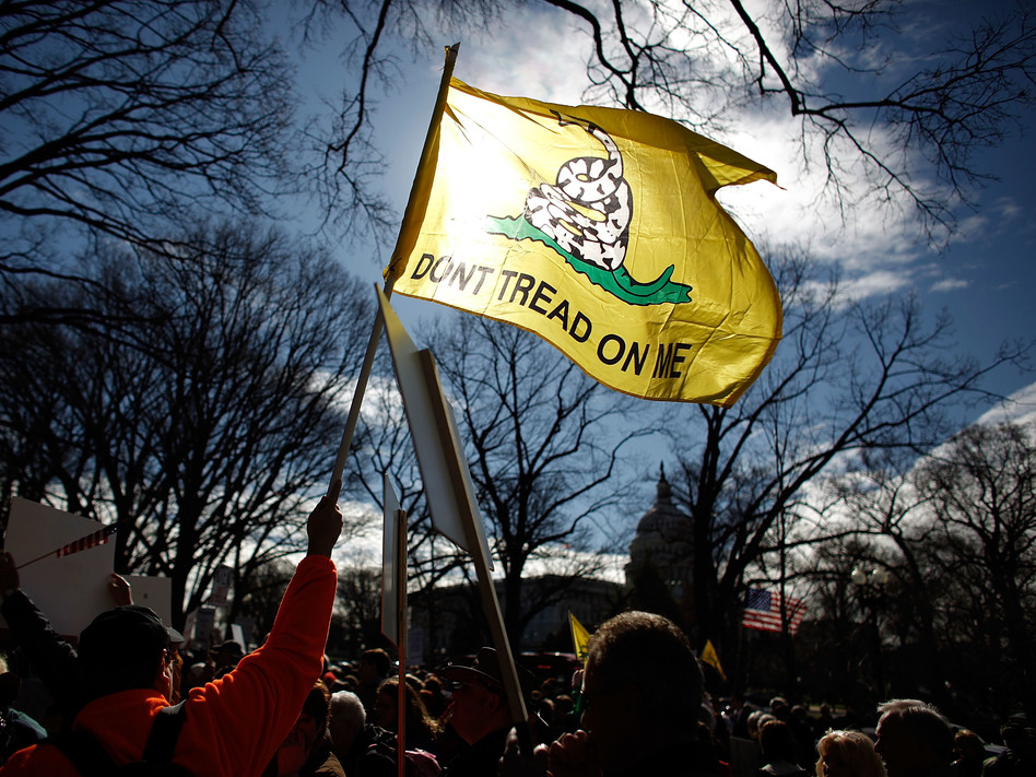 Tea Party activists hold a rally on Capitol Hill in 2010. That grassroots movement, with backing from the Koch political network, helped Republicans win back the House in the 2010 midterms. In 2018, the Koch network is on defense against Democratic gains. (Chip Somodevilla/Getty Images)
