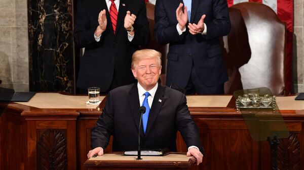 President Trump listens to applause before delivering his State of the Union address Tuesday night at the Capitol in Washington.
