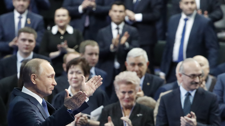 Russian President Vladimir Putin, seen here during a campaign meeting with supporters on Tuesday, compared the U.S. list to a dog barking at a caravan. (Grigory Dukor/Reuters)