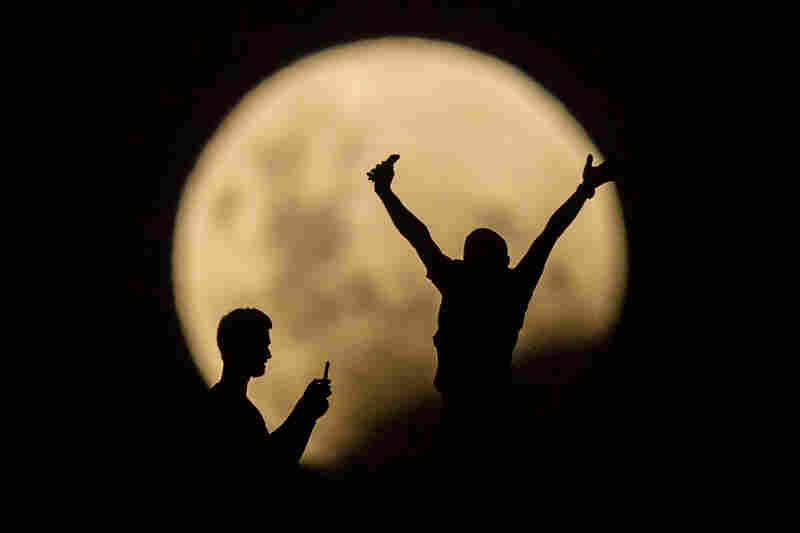 People in Lancelin, Australia, take photos of the supermoon. Last seen from Australia in December 1983.