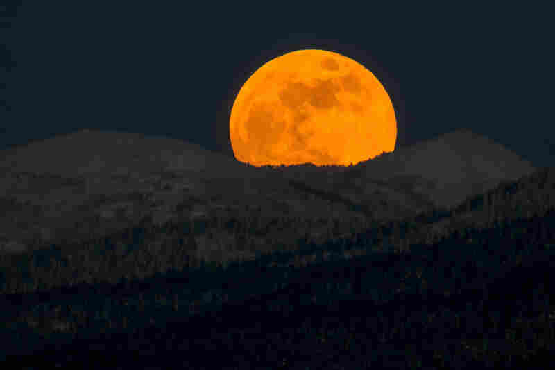 A red supermoon rises over hills near the city of Yuzhno-Sakhalinsk on Sakhalin Island in Russia's Far East.