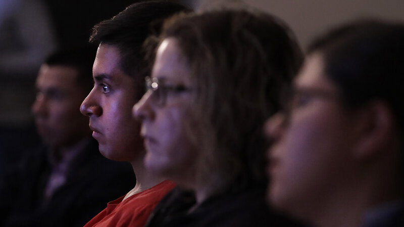 Victor Guzman, an undocumented resident, watches President Donald Trump speak during a State of the Union watch party Tuesday in Chicago. (Charles Rex Arbogast/AP)