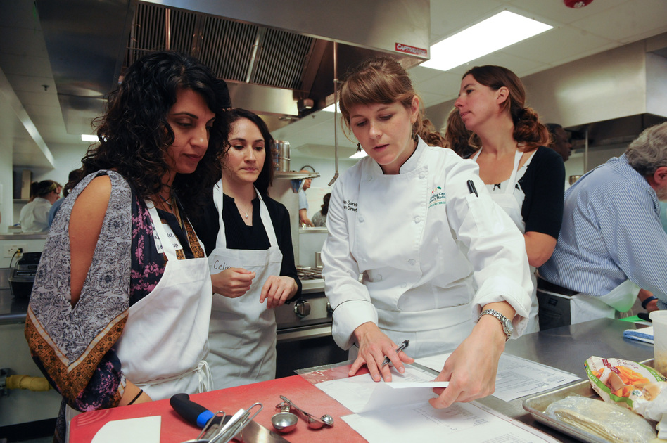 Leah Sarris (center) is the head chef and program director at the Goldring Center for Culinary Medicine at Tulane University. She teaches healthy cooking techniques and educates people about the significant role that food plays in preventing and managing diseases.