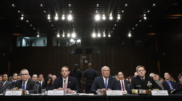 Then-acting FBI Director Andrew McCabe, Deputy Attorney General Rod Rosenstein, Director of National Intelligence Dan Coats and National Security Agency Director Adm. Mike Rogers testify on Capitol Hill in June. The Nunes memo may change the way their agencies work with Congress.