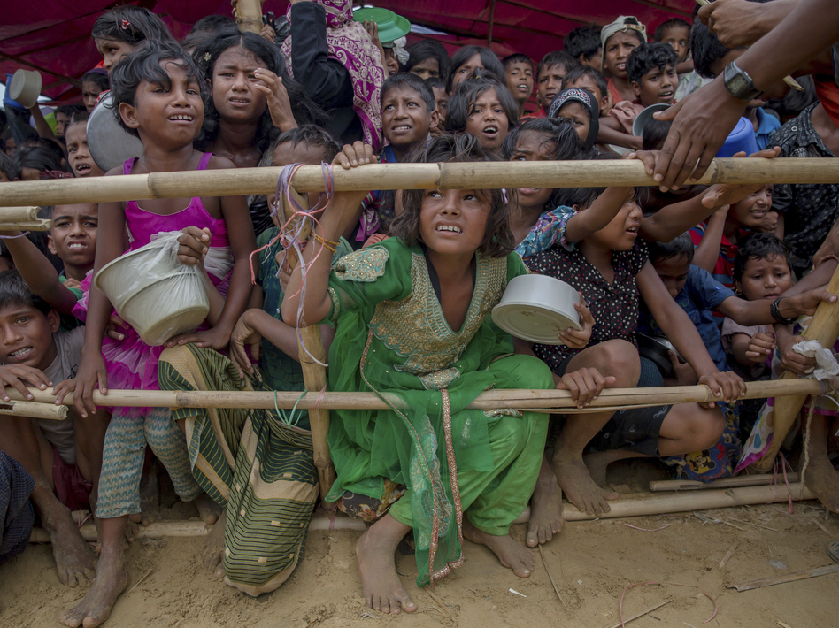 Rohingya Muslim children, who crossed over from Myanmar into Bangladesh, wait squashed against each other to receive food handouts distributed to children and women by a Turkish aid agency at Thaingkhali refugee camp, Bangladesh, in October. (Dar Yasin/AP)