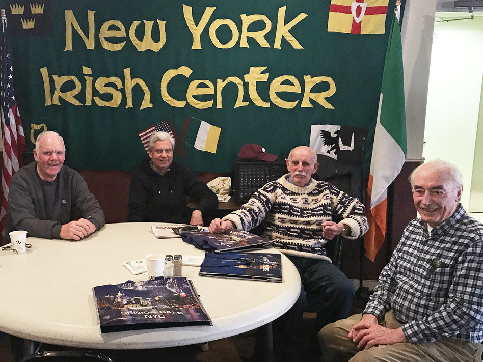 From left to right, Tommy Shiels, Dennis Hayden, John Houlihan and Thomas Ring attend the New York Irish Center's weekly luncheon for seniors in Queens, N.Y. Many attendees say they support the 2020 census asking white people about their origins. (Hansi Lo Wang/NPR)