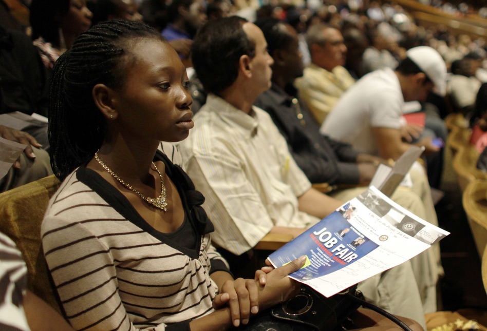 People in Miami, Fla., attend a 2011 job fair sponsored by the NAACP meant to lower the high rate of unemployment in the black community. (Lynne Sladky/ASSOCIATED PRESS)