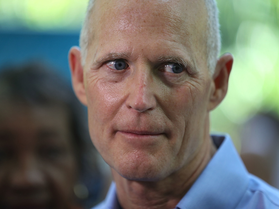 Florida Gov. Rick Scott at a news conference in May in Miami. A decision by a federal judge to strike down the state's procedure for restoring voting rights to felons who have served their time is seen as a defeat for the governor. (Joe Raedle/Getty Images)