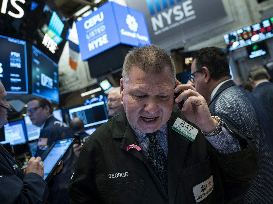 Traders at the New York Stock Exchange on Friday. The Dow Jones industrial average fell 666 points amid signs that interest rates are heading higher. (Drew Angerer/Getty Images)
