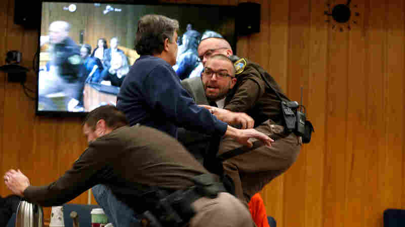 Victims' Father Lunges At Larry Nassar In Michigan Courtroom