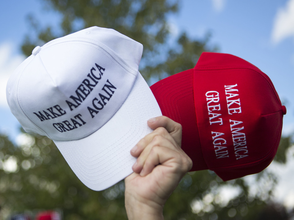 A vendor sells hats to supporters before a campaign rally for then-candidate Donald Trump in Newtown, Pa. While sales of Trump merchandise helped fund his campaign, large donors increasingly dominate the funding of political campaigns. (Jessica Kourkounis/Getty Images)